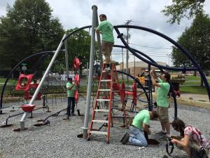 Volunteers, some of them municipal officials attending the Pennsylvania Municipal League convention in Allentown, help renovate Jordan Park.